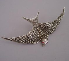 """SILVER and marcasite swallow bird brooch with red rhinestone eyes, marked """"silver"""""""