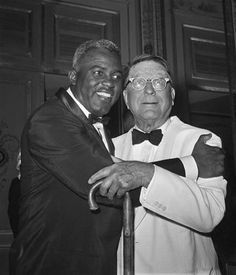 FILE - In this July 20, 1962 file photo, baseball player Jackie Robinson embraces Branch Rickey in New York. Rickey was general manager of the Brooklyn Dodgers when Robinson was hired. The home area of the late baseball executive Rickey expects increased interest in his southern Ohio roots from his depiction in the movie 42, in which Harrison Ford plays the man who signed Jackie Robinson to challenge baseballs color line. (AP Photo/File)