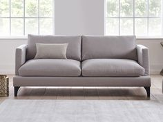 Ewan Sofa - The subtle detailing of the hand-carved wooden legs reveals the high level of craftsmanship and care taken to produce Living It Up's sofas - by www.livingitup.co.uk