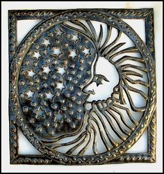 "Moon Haitian Upcycled Metal Art Wall Hanging  by HaitianMetal, $84.95  This handcrafted decorative sun design measures 22"" x 24"".  This moon wall hanging is hand cut from re-cycled - recycled 50 gallon steel drums"