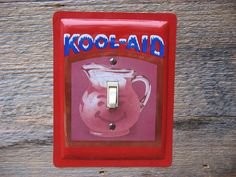 Light Switch Plate made from a Kool Aid tin by tincansally