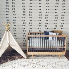 all the new nursery essentials: a teepee, whimsical wallpaper + DwellStudio bedding