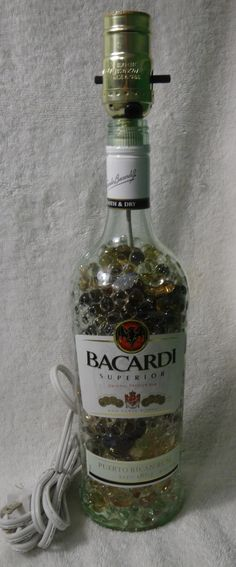 Hey, I found this really awesome Etsy listing at https://www.etsy.com/listing/211947894/bacardi-rum-bottle-lamp-striking