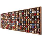 Saw this on Million Dollar Decorators - Kathryn Ireland used it as artwork in a living room and loved it! - French Wood Rack with Wool Yarn Bobbins at 1stdibs
