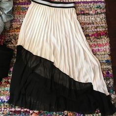 zara skirt beautiful skirt but has a faint stain on front under elastic waist band.. Zara Skirts