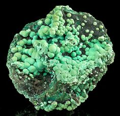 Malachite balls on matrix, 1880 - 1890 timeframe.From Bisbee, Cochise County, Arizona. Measures 9.8 cm by 8.7 cm by 4.6 cm in total size.