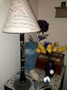 Clarinet lamp with music sheet lamp shade. I know it isn't colorful, but this is a cool idea for old broken clairinets.