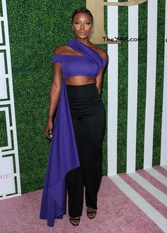 """Model/actress Eva Marcille was styling on the carpet in a purple crop top accentuated with a cape, paired with black high-waisted pants. The """"Top Model"""" chick will be attending the BET Experience """"Hip Hop in Heels"""" session at the Love Healthy Lounge and Wellness Pavilion on Saturday."""