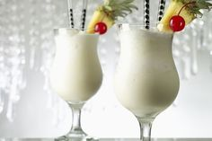 Coconut and pineapple mix with rum and cream in a blender to create a fresh, frozen Pina Colada that is great all summer long.