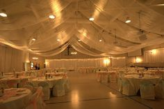From plain old gymnasium to wedding reception - ceiling draping. - - From plain old gymnasium to wedding reception – ceiling draping. The Wedding! From plain old gymnasium to wedding reception – ceiling draping. Gym Wedding Reception, Wedding Venues, Reception Ideas, Ceiling Draping, Ceiling Decor, Wedding Card Design, Wedding Cards, Wedding Ceiling, Church Wedding Decorations