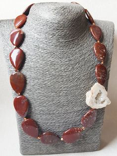 Natural Indian Agate Drop Bead Natural Crystal White Agate Geode Druzy Nuggets Necklace Natural Indian Red Agate Drop Earrings  Indian Agate Drop Bead 30x20x6mm  On the outside, agate geodes appear to be nothing but rock, but looking deeper into the interior of a geode will reveal amazing crystal growth and formations. Agate geode crystals are usually composed of quartz or chalcedonic deposits, but various other minerals such as calcite, celestite and dolomite are also commonly found within…