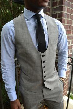 No one ever complained of a nicely tailored grey vest. men's #fashion around the office.