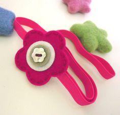 Wool felt elastic headband -Button flower -raspberry (pick your size). $6.00, via Etsy.