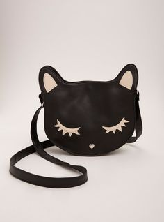 """This is a purr-fect handbag. The crossbody style is constructed with smooth black faux leather, lending a mod-ish feel. But the body has a major meow-ment with a kitty cat shaped head detailed with white faux leather patches.<div><ul><li style=""""list-style-position: inside !important; list-style-type: disc !important"""">11"""" X 8.5"""" X 2.5""""</li><li style=""""list-style-position: inside !important; list-style-type: disc !important&..."""