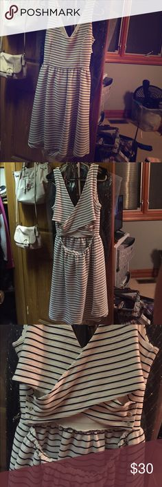 Lauren Conrad navy and white striped dress Navy and white striped dress with back detailing. Never worn, great condition LC Lauren Conrad Dresses