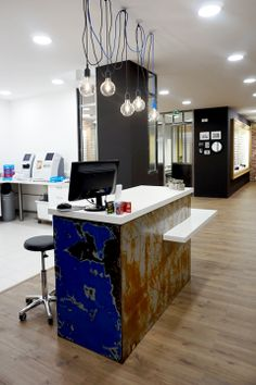 """Retail shop design. """"L'art de Voir"""" Optical shop . Designer: Pierrick Poncet. Reclaimed metal container as main counter . Muuto pendant lights ."""