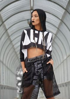 Black Mob The Label THE HOODED BOX CROP $79.00 The Hooded Box Crop is a poncho style crop with a full width scuba front, soft finish mesh back/hood and ribbed cuffs. Exclusive Black Mob The Label logo sublimation print to full front. 100% Polyester Scuba Knit / 100% Soft Polyester Mesh Model wears size small. Made to order, please allow 14-21 days for delivery. These prints are exclusively designed by Black Mob The Label. Designed and made in Brisbane, Queensland, Australia.
