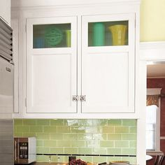 Rather than stacking glass-doored cubby units over upper cabinets, just order tall two-panel wall cabinets with squares of glass at the top. You'll save 25 to 45 percent.