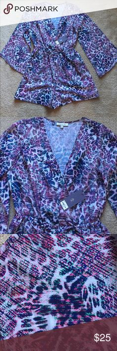 NEW Jennifer Lopez Bell Sleeve Romper medium NEW Jennifer Lopez Bell Sleeve romper, 100% polyester, size Medium Jennifer Lopez Tops