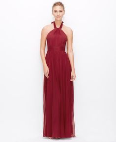 """Exquisitely draped in lightweight silk georgette, this gorgeous gown flaunts a head-turning halter neckline for a femme finish. Shirred halter neck with ties. Ruched inset waistband. Hidden back zipper with hook-and-eye closure. Hidden elasticized back waist. Lined. 45"""" from natural waist. </p> <p> <br /> <br /> <em><span style=""""color: purple;"""">Items in our Weddings """" Events Collection can only be exchanged or returned by mail. <br /></span></em></p>"""