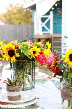 Pretty summer flowers in chicken wire vase.  The Handmade Home.