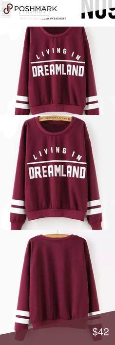 Dreamland Sweatshirt Maroon dreamland cotton pullover sweatshirt, with white print word detailing. Tops Sweatshirts & Hoodies
