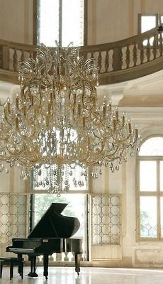 That's gotta be one huge chandelier to make that piano look so small.