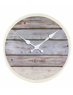 NeXtime The Home Plank clock creates a feeling of blue skies, seagulls and sand under the feet. Made out of real wood, with a Mediterranean sun-bleached look, this clock turns every home or office into an Ibiza beach club! Finish: Grey, Size: H x W x D Wall Clock Wooden, Wooden Case, Diy Wall Clocks, Wood Wall, Wall Clock Online, Wall Clock Design, Plank Walls, Diy Wall Decor, Home Decor Outlet