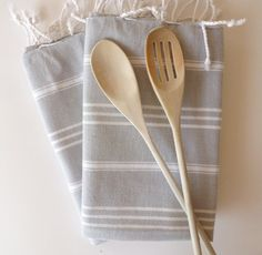 peshkir: little sister to the peshtemal, can be used as a hand towel, dish towel, oversized napkin, placemat, or doll blanket; anything the peshtemal is too big for, the peshkir can probably handle. Set of  2 Turkish Hand Towel (Peshkir), Gray