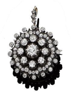 A diamond target brooch/pendant, circa 1880 The circular openwork plaque centrally-set with a cluster of old brilliant-cut diamonds in pinched collet-settings, within a similarly-cut diamond surround, mounted in silver and gold