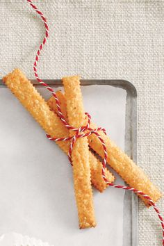 Cheese Straws - Host a British-Style Tea - Southernliving. Recipe: Spicy Cheddar Cheese Straws  Add a little spice to your celebration with these savory straws. Kick it up a notch by adding a little more red pepper.