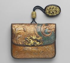Tobacco-pouch; oval kagami netsuke with design of chrysanthemums; ojime with design of mantis, bird and plants; kanamono in the form of a hawk attacking another bird, sparrows and autumn plants; inner plate with butterfly and plants | Museum of Fine Arts, Boston