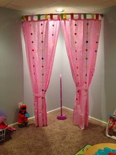 Here's a playroom stage idea. I used a curved shower curtain rod. It is a Zenith brand from Amazon. The curtains are from Ikea!