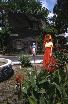 "Women standing in front of the ""Oldest Wooden School House in the U.S."" in St. Augustine! (1953) 