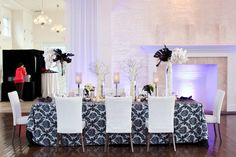 This black and white wedding table set-up is perfect for a winter celebration!