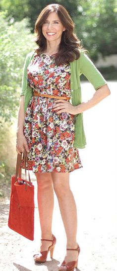 This pretty floral dress is fresh and feminine and perfectly accessorized with a skinny belt and red accessories.