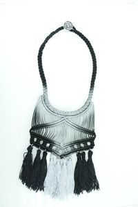 A unique macramé necklace from my winter collection 2011 with black cord (4mm)   and ten tassels at the end.