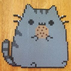 Pusheen eating a cookie perler beads by sophia_lily_13