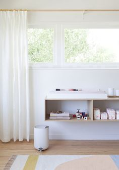 Montessori home ideas - low shelves used as change table, then put activities on them later on.