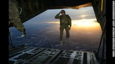 U.S. Army 10th Special Forces Group makes a jump into Germany. Soldier salutes as he steps off the deck...