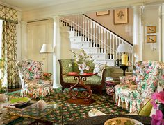 Perfect example of attaining lots of color from furnishings and decor with plain walls. From McMillen Inc. patterns on patterns, shingle style.