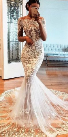 Mermaid wedding dress with sleeves - The dress expands, beginning from the knee area. The dresses may also be customized made based on the physique a...