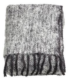 Throw in soft, jacquard-weave bouclé fabric with a herringbone pattern. Fringe on short sides.