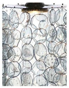 "The Petal Lamp Shade has approximately 200 ""petals"" that were individually cut from recycled PET bottles, heated and engraved with subtle patterns. They dangle 21.6 inches from a stainless steel disk. By Gülnur Özdağlar, architect, in Ankara Turkey"