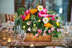 love these florals of poppies + artichokes + peonies by La Martiné Floral Design