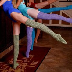 Peony & Moss Marled Cable Thigh High Socks Green Dried Herb Marled Cable Knit Thigh High Socks  Thigh high socks in a marled yarn of green and black twisted together.  Beautiful intricate cable knit pattern from foot to top of leg.  Specially made for Peony and Moss in North Carolina, these luxurious knee high socks are perfect with boots for fall.  Made from, thick, lofty, soft cotton, they are long lasting and durable  80% soft, absorbent cotton, 15% nylon for shape, 5% spandex for stretch…