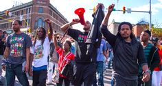 Demonstrators chant on Pennsylvania Avenue in Baltimore, Maryland, April 28, 2015, one day after violence and looting erupted following the funeral of 25-year-old African-American man Freddie Gray, who died in police custody (AFP Photo/Jim Watson)