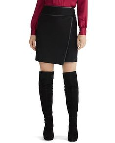 Short and stylish black mini skirt with wide banded waist, touches of leather and asymmetrical wrapped front for subtle slimming properties. Dress it for work with a structured blouse or show your personality and pair with an animal print top.