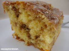 Honeybun Cake - A super easy cake swirled with cinnamon and sugar and covered with a gooey vanilla glaze.  A family favorite.
