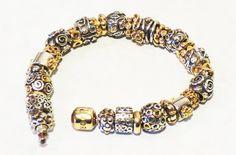 Authentic Pandora Bracelet...lots of GOLD!